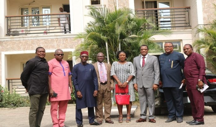The Perm. Sec. Federal Ministry of Environment Dr. Bakari Wadinga 3rd from right and on his immediate left is the head of Human Resources in the Council who is also overseeing the Council, Mr. Victor Mba while at the extreme right is the head, Media and Public Communications, Mr. Kehinde A. Openibo, on the immediate right of the Perm. Sec is the Personal Assistant, Gloria Balat, the head of DRESE in the Council , Dr. Andy Ukah, the Council's Accountant Mr. Abubakar Adamu, the Special Assistant to the Permanent Secretary , Mr. Adegoke Emmanuel, all posed for picture taking during the Courtesy visit to the Council
