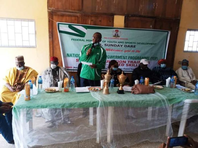 ccasion of the Closing Ceremony of the National Youth Empowerment On Sustainable Livelihood Programme In Agriculture for Unemployed Youth at the National Youth Development Centre, Shere Hills, Jos-Plateau State on 19th Feb 2021. 3rd Left: Representative of the Hon. Minister of Youth & Sports Development, Mr Emmanuel Essien, ( Deputy Director in the Ministry) delivering the speech of the Hon. Minister to participants/ trainees