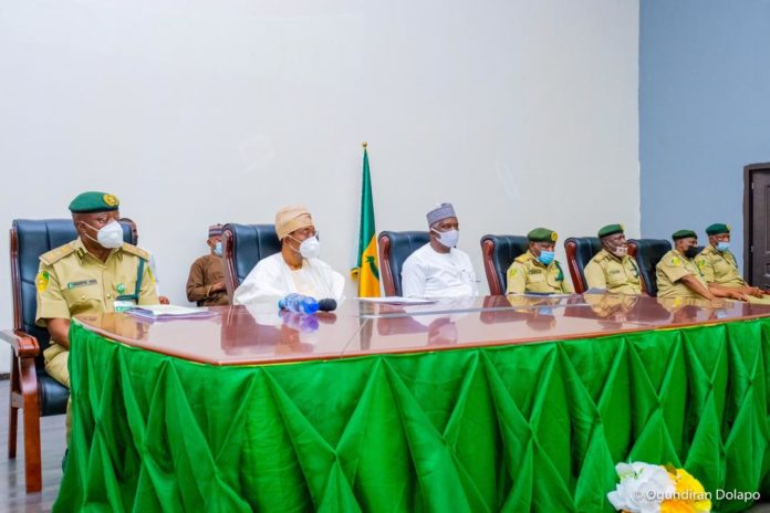 Minister of Interior, Ogbeni Rauf Aregbesola (2nd Left), Perm. Sec. Min. of Interior, Dr. Shuaib Belgore (3rd Left), Ag. CG of NCoS, John Mrabore (1st Left) and others during the HMI's Meeting with Squadron Commanders of NCoS in Abuja on Friday.