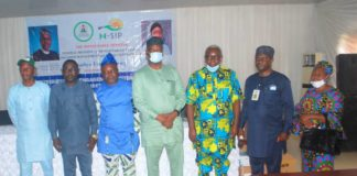 Fourth left: Representative of the Honourable Minister of Humanitarian Affairs, Disaster Management and Social Development, Babatunde Jaji, Second left, Representative of the State Focal Person, Barrister Silvanus Iyang, First right, Conditional Cash TransferChairperson, Godwin Achoda, Third right NHGSFP Chairperson Gabriel Okulaja, Third left NOA Assime Usetu Ogban and others during the IMs Flag Off and Distribution of Engagement Letters and Tablets in Ministry of Finance Government, Hall Calabar, Cross River State July 3, 2021.
